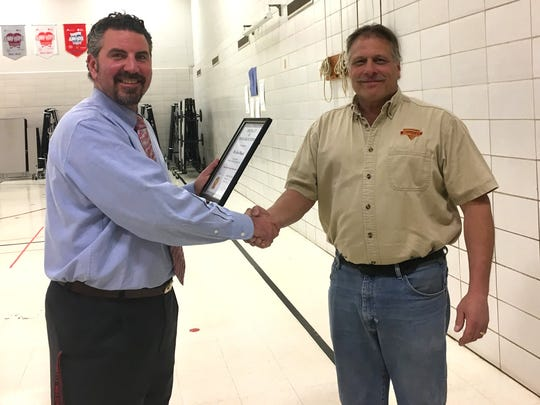 """Wilson Elementary Principal Chad Renzelmann, left, gave Chuck Miesfeld a """"Special Friend of Wilson"""" award in front of the Wilson student body recently."""