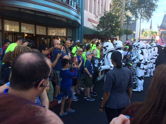 Many from the group from Evansville (in the lime green shirts) got a firsthand look at some stormtroopers during the March of the First Order at Planet Hollywood on Thursday. A large group of stromtroopers turned and faced the Evansville group during a pause in the march.