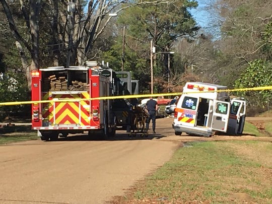 Police, fire, and ambulance crews respond to the scene of a shooting on Churchill Drive in Jackson Monday.