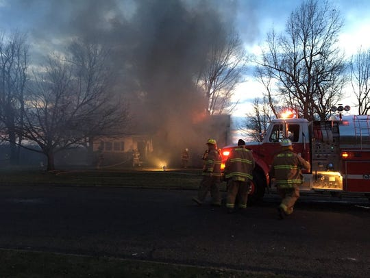 Firefighters battle a blaze on Walnut Drive South on