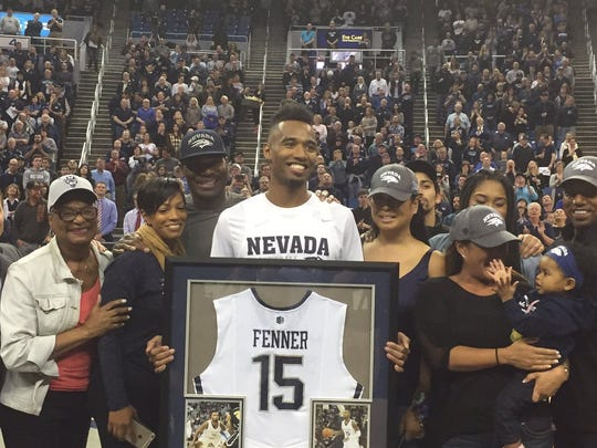 D.J. Fenner's family celebrates with him prior to his senior night game last week.