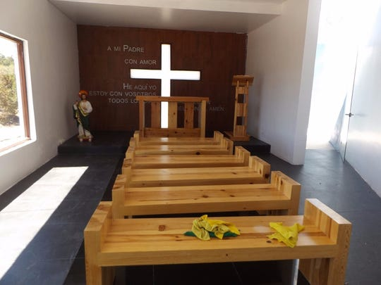 """A chapel wall states """"To my father with love"""" at a ranch raided Saturday by Chihuahua state police."""