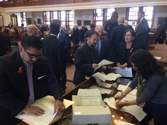 El Paso Democrat Joe Moody (center) files an amendment to the sanctuary cities bill in the Texas House on Wednesday, April 26, 2017.
