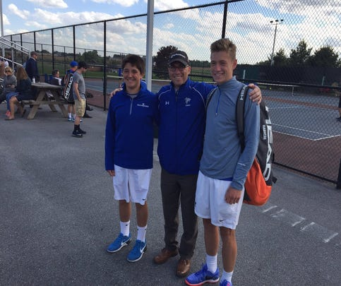 Cedar Crest tennis players Dylan Tull, left, and Jack Muraika pose with head coach Mike Rohrbach before taking the court for the Lancaster-Lebanon League Flight One AAA singles final on Tuesday at Conestoga Valley. Muraika won the match, 6-2, 6-0, then teamed with Tull to win the AAA doubles championship.