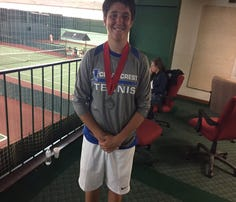 A happy Cedar Crest  Dylan Tull with his district silver medal.