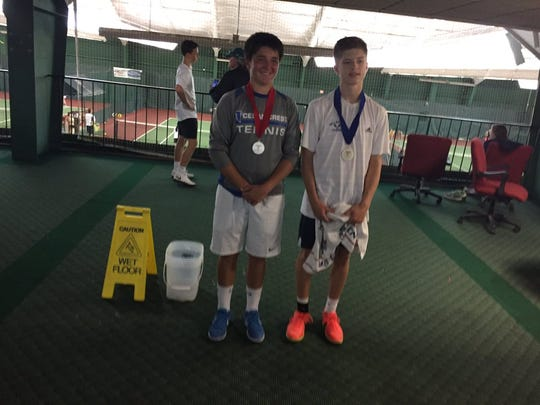 Cedar Crest's Dylan Tull, left, and Dallastown's Holden Koons pose with their district medals. Koons defeated Tull, 6-1, 6-2 to win the 3A singles  title for the second straight year.
