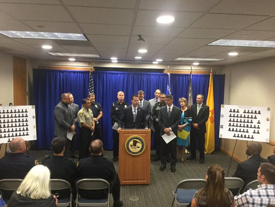 ATF officials join local law enforcement at a news