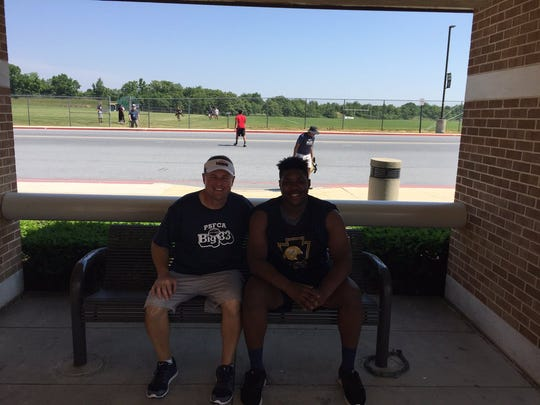 Lebanon's Gerry Yonchiuk, left, and Khalique Washington find some shade after Monday morning's Big 33 practice.