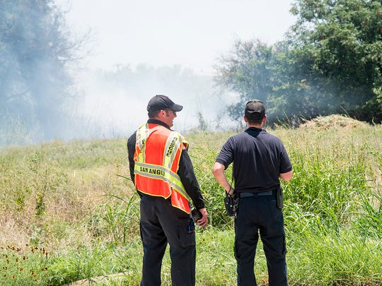 San Angelo firefighters respond to a grass fire near Bryant Boulevard and 14th Street on Wednesday afternoon.