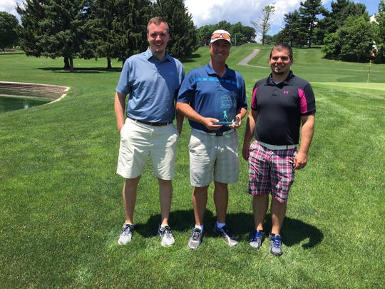 Dan Brown, center, captured his third Lebanon County Amateur Golf title last year at Fairview Golf Course. Presenting Brown with the trophy were tournament director Justin Arnt, left, and assistant director Jon Day.