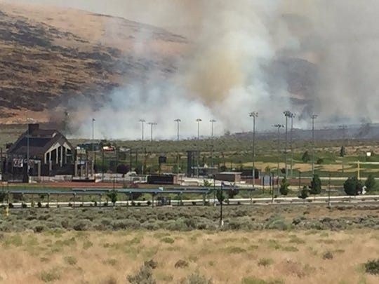 A wildfire burns Monday, July 3, 2017 near Golden Eagle sports complex in the Spanish Springs area of Sparks