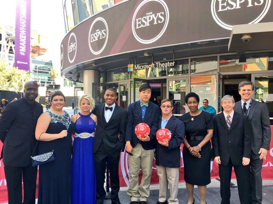 Daina Shilts of Neillsville, third from left, poses for a photo with seven other Special Olympics athletes and Tim Shriver, right, outside of the 2017 ESPY Awards on Wednesday, July 12, 2017.