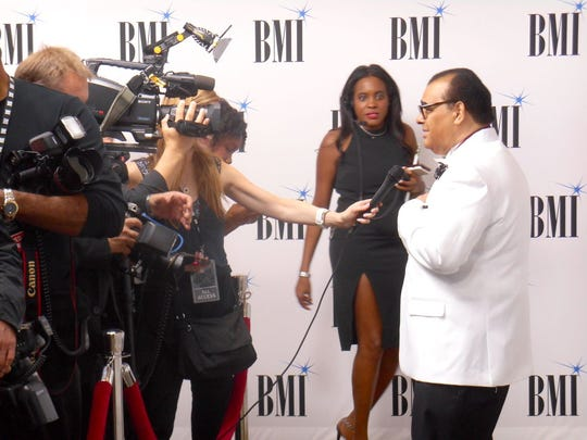 Timmy Thomas speaks to an interviewer at a BMI Press