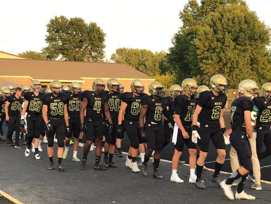 West busted out a black-on-black look for Friday's