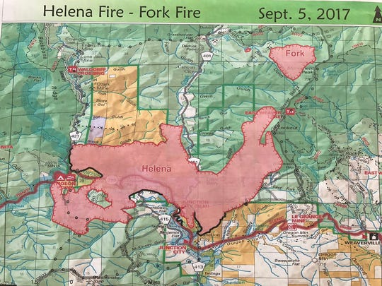 This image shows a map displaying the current boundaries of the Helena and Fork fires near Weaverville. The Helena Fire has burned more than 11,000 acres as of Tuesday.