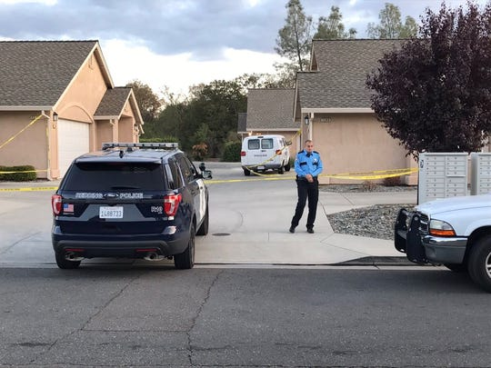 Police investigate a homicide at Heavenly Oak Lane and Lofty Oak Drive in south Redding on Sept. 21.
