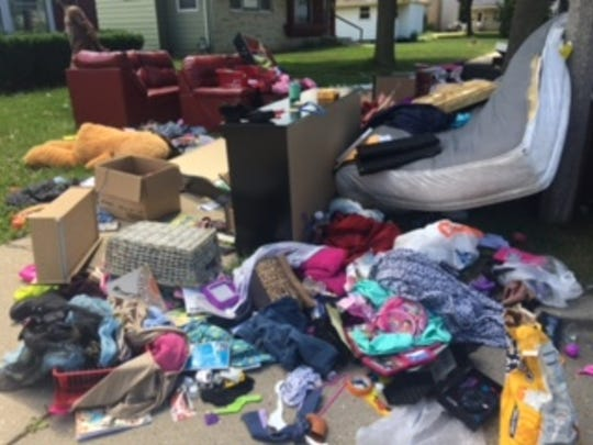 These pictures were taken by Alishia Evans, who briefly lived in a house on the 5700 block of N. 81st St. She was evicted from the home and all of her family's belongings were put on the curbside. She said pictures were taken after looters had already taken a lot of her stuff.