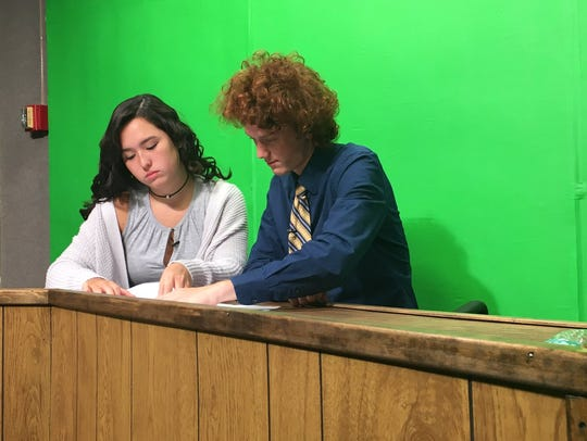 Students prepare at the CHTV anchor desk before the