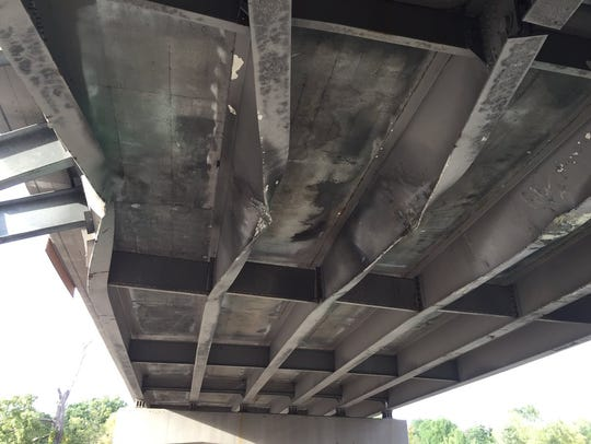 A photo of damage to the Pleasant Valley Road bridge