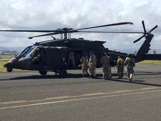 Disaster Medical Assistance Team members board an HH-60