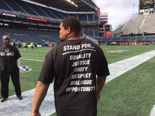 The Indianapolis Colts are wearing these T-Shirts ahead of playing the Seattle Seahawks.