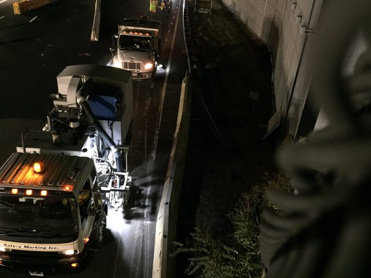 Trucks get rid of the striping on the highway during
