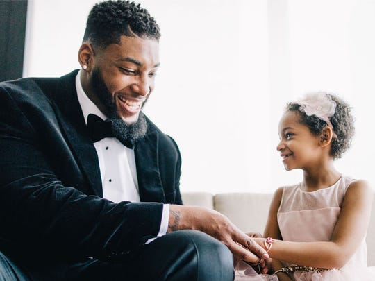 Devon Still and his daughter, Leah, at the wedding