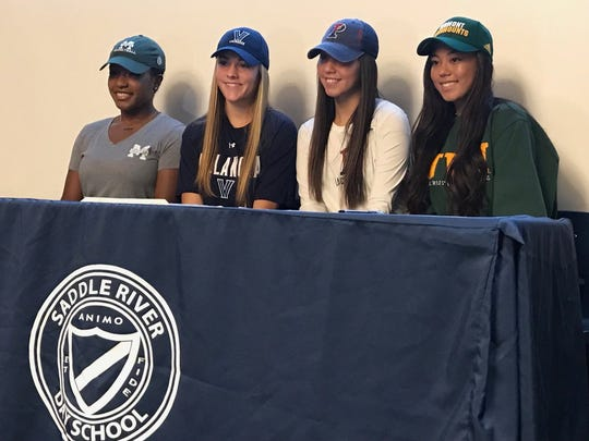 (From left to right) Sydney Watkins, Alexis Tsahalis, Michaela McMahon and Carolyn Carrera at Saddle River Day on National Signing Day on Nov. 8