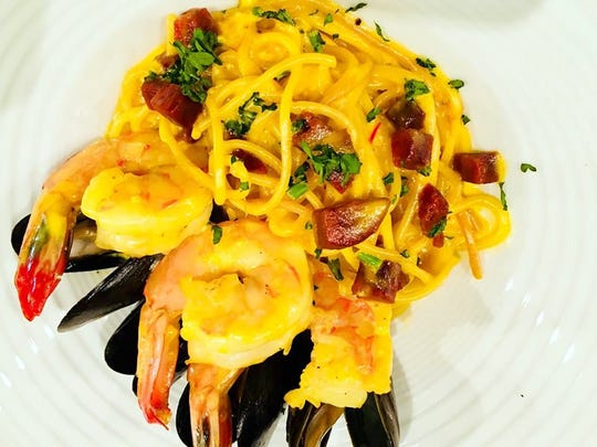 Fideos includes caramelized pasta, seafood, chorizo and saffron at The Cave Bistro & Wine Bar in the Galleria Shoppes at Vanderbilt in North Naples.