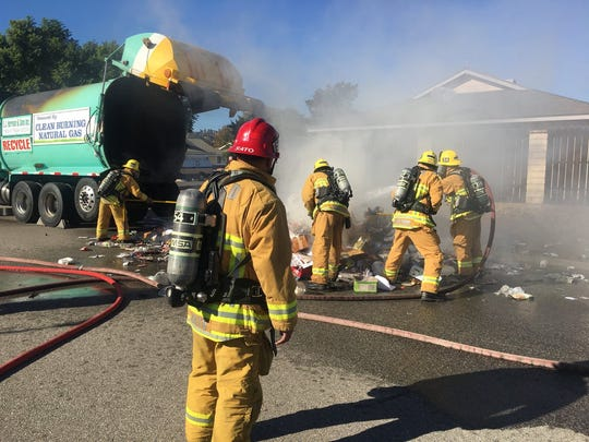 Ventura County fire crews put out a fire in the back of a trash truck Thursday afternoon in Camarillo.