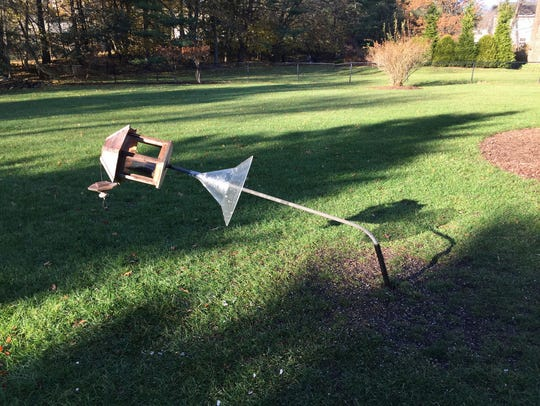 A bear bent this Allendale resident's feeder in late