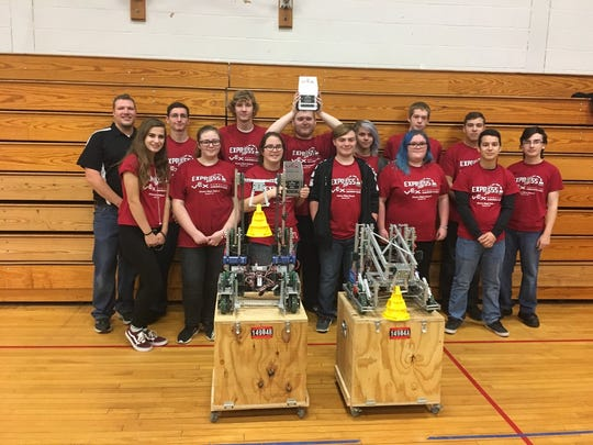 The Express Robotics Club poses with their robots and awards during the VEX Robotics Competition in Fallsburg.