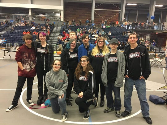 A team from the Express Robotics Club poses during