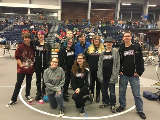 A team from the Express Robotics Club poses during the VEX Robotics Competition in Fallsburg.