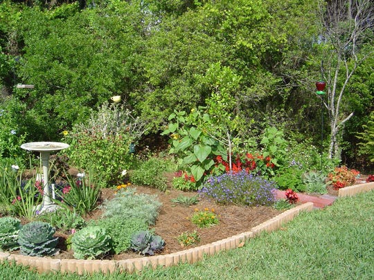 Perennial beds, maybe with some annuals splashed in there, require less maintenance than turf areas. Birdbaths and feeders attract wildlife.
