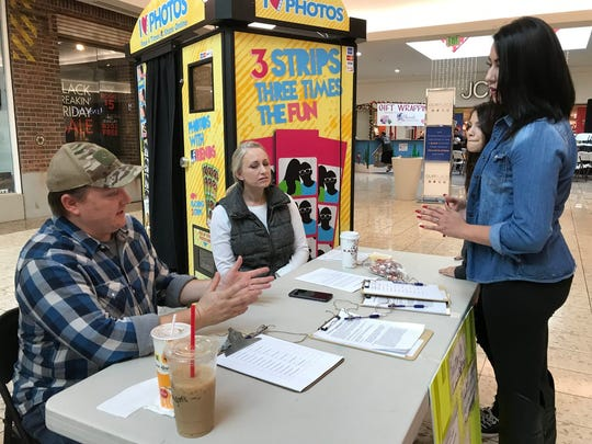 Patrick Gorman, left, and Jill Gorman, center, speak to Samantha Higuera, of Redding, in November at the Mt. Shasta Mall. The Gormans wereon a signature-gathering campaign to re-examine whether commercial recreational and medicinal marijuana activity should be allowed in the unincorporated areas of Shasta County.