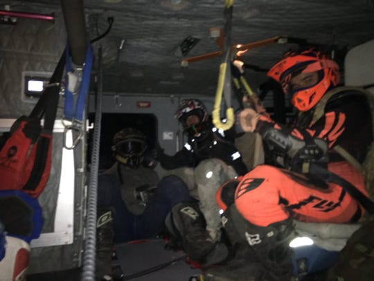 A dozen off-road motorcyclists were airlifted out of the Los Padres National Forest after a Ventura County Sheriff's helicopter searched for them Sunday night.