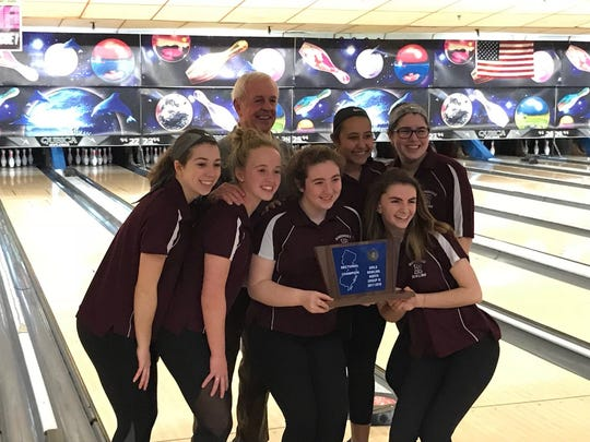 "The Ridgewood girls bowling team earned its first North Group 4 sectional title since 2013 on Saturday, Feb. 10, 2018 at Bowler City. From left: Christina St. John, Carley Santangelo, coach Dick Bennett (back), Claire Harris, Francesca ""Chachi"" Chinea, Madison Murphy and Caroline Gervolino."