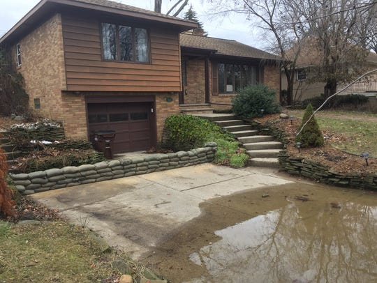 Couple in Lansing hopeful water doesn't creep up to their garage north of Mount Hope.