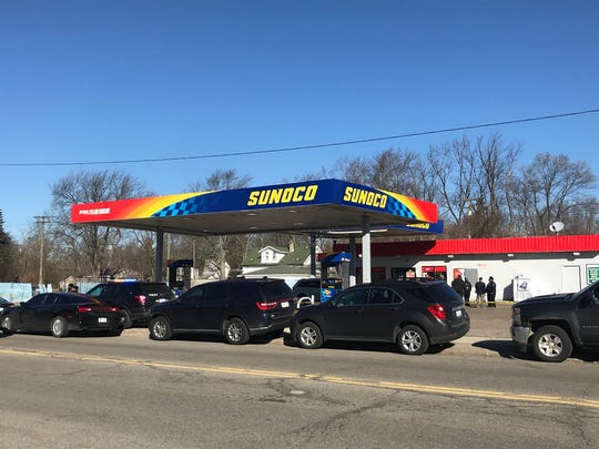Police investigate the taped-off scene at a Sunoco gas station at 22700 Fenkell Ave. on Monday, Feb. 26, 2018.