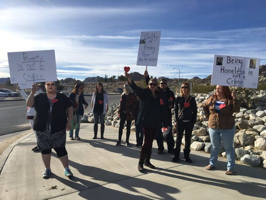 Supporters gather outside a Joshua Tree courthouse Tuesday, March 6, 2018 for parents accused of child abuse after their kids were found living in shack.