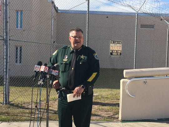 Sheriff Wayne Ivey gives a press conference outside