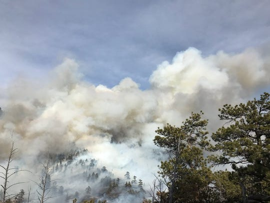 Smoke rises from the Red Feather Prescribed Burn on