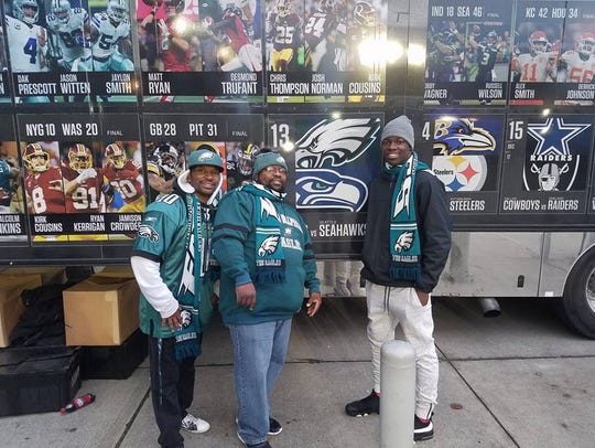 Malachi DeWalt with friends at a Seahawks-Eagles game.