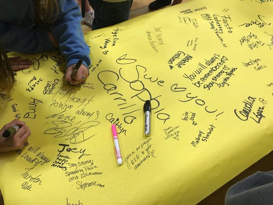 Anderson High School students signed a poster to send