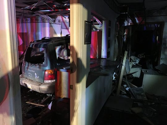 People evaluate the scene after a Gettysburg man suspected of driving under the influence crashed into the Hamilton Township municipal building in the 200 block of Mummerts Church Road on March 31.