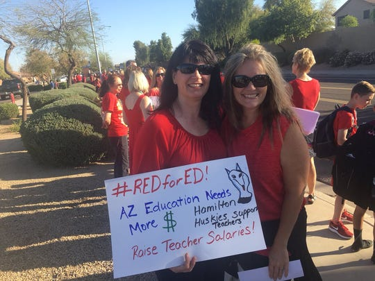 Michelle Dexter (left) and Jill Graham stand with teachers
