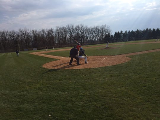 Elco freshman Dakota Smith delivers a pitch during