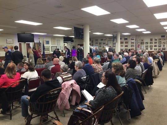 Members of the Hanover community file in and find seats at the public meeting introducing the borough's streetscape project to improve the downtown district. More than 100 people attended the April 11, 2018 meeting.