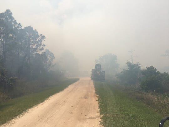 State Wildland Firefighters worked Wednesday to contain a brush fire that grew to 80 acres in St. Sebastian River Preserve State Park.